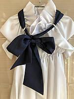 Блуза-туника Remix атласная с коротким рукавом и синим бантом
