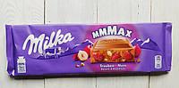 Шоколад Milka Trauben Nuss молочный шоколад с орехами и изюмом 270g Швейцария