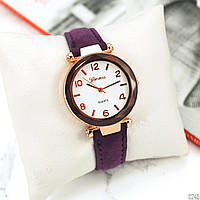 Часы  G.e.n.e.v.a. Механизм - кварцевый. Материал ремешка - кожзам. Цвет покрытия часов - под золото.