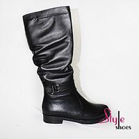 Женские зимние сапоги из натуральной кожи черного цвета на низком каблуке