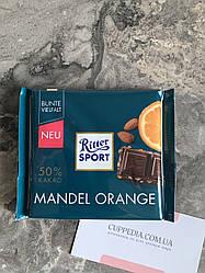 Шоколад Ritter Sport 50 % какао с миндалём и апельсиновой цедрой
