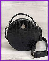 Стильная женская сумка  черного цвета под рептилию