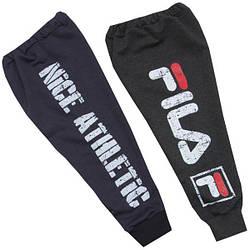 Зауженные спортивные штаны для мальчика с принтом