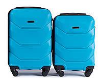 Комплект пластиковых чемоданов на 4 колесах Голубой