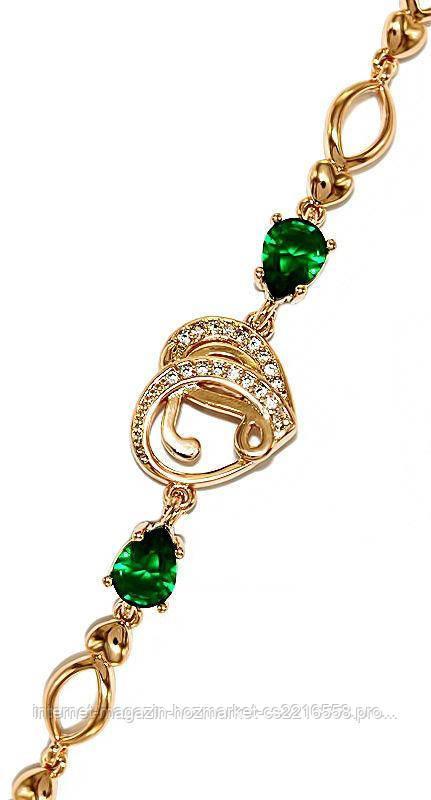 Браслет фирмы XР, цвет:позолота. Камни:белый и зелёный циркон. Длина: 17-21 см. Ширина: 12-6 мм.
