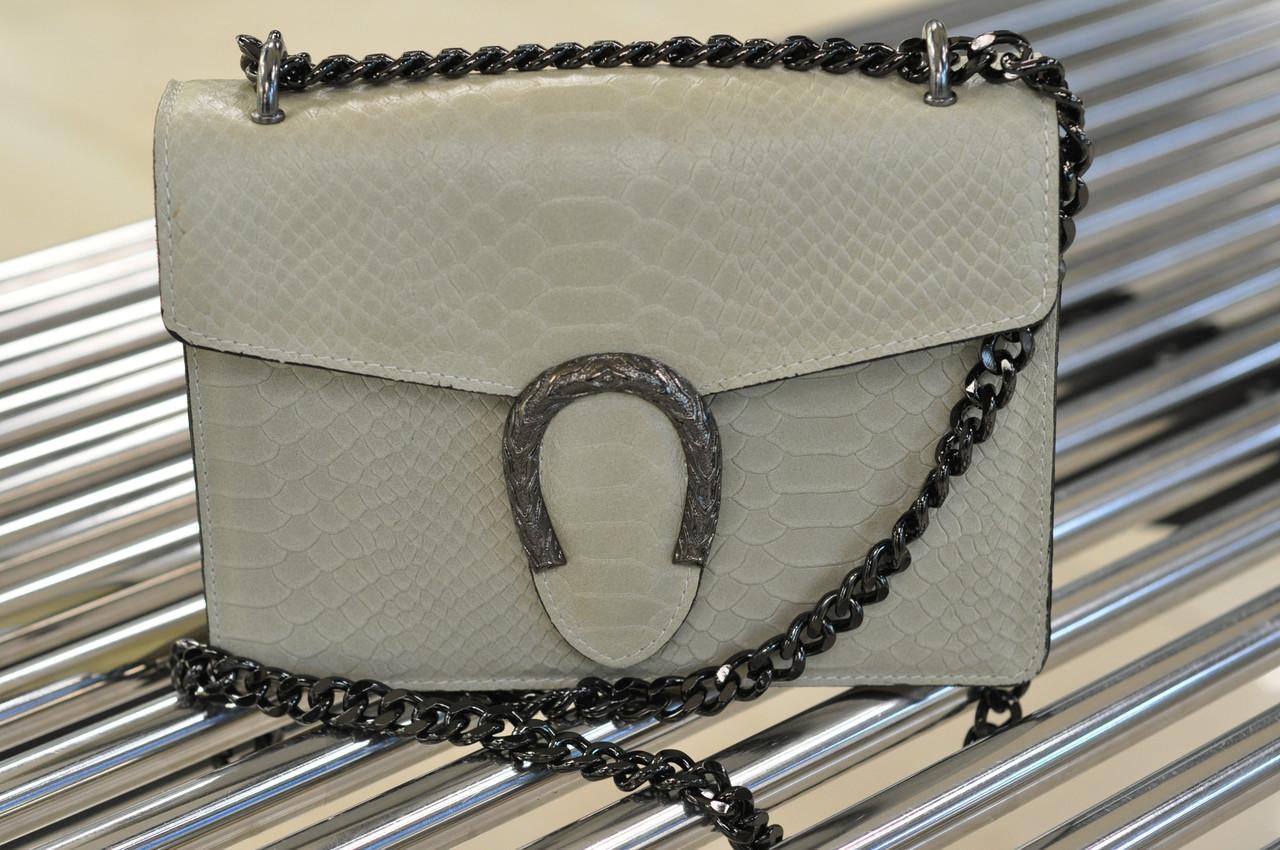 Кожаная женская светлая сумочка с тиснением