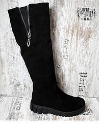 Зимние замшевые сапоги на низком каблуке
