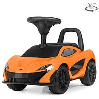 Каталка-толокар Z372L-7 оранжевого цвета,сиденье экокожа.