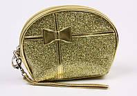 Косметичка лаковая золотистая с бантиком