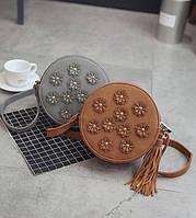 Женская круглая сумочка с цветами