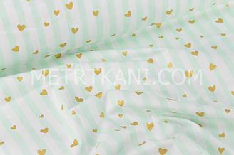 Ткань хлопковая с золотыми сердечками на мятно-салатовых полосках (глиттер) на белом № 1043