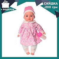 Пупс игрушечный в розовой одежде с бутылочкой M 3887 UA LIMO TOY мягконабивной, музыкально-звуковой   куколка, фото 1
