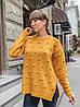 Свободный свитер оверсайз с разрезами по бокам