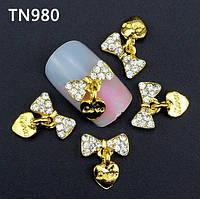 Бантик с камнями для дизайна ногтей золото.Размер 9х12мм.Цена за 1шт