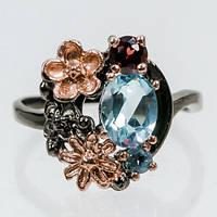 Серебряное кольцо с голубым топазом, 8*6 мм., 1256КТ