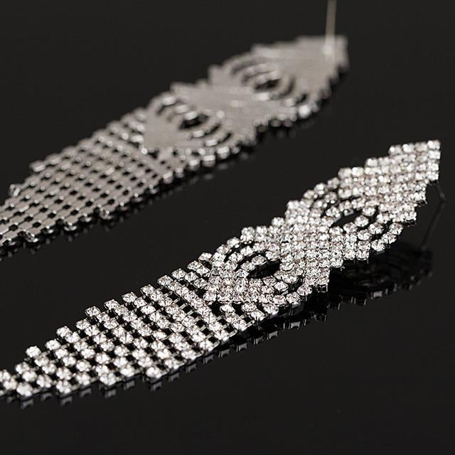 Серьги-подвески . Длинные серьги с камнями