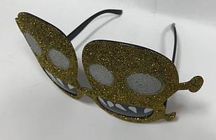 Очки с черепами золотистые