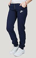 Теплые спортивные штаны больших размеров женские на флисе зимние на манжете, темно синие