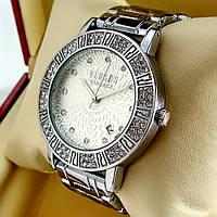 Женские кварцевые наручные часы Versus Versace серебряного цвета с серебряным циферблатом с датой на браслете
