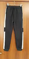 Теплые спортивные брюки для мальчика на флисе черные с белыми вставками 158 176