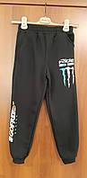 Теплые спортивные брюки для мальчика на флисе черные 158