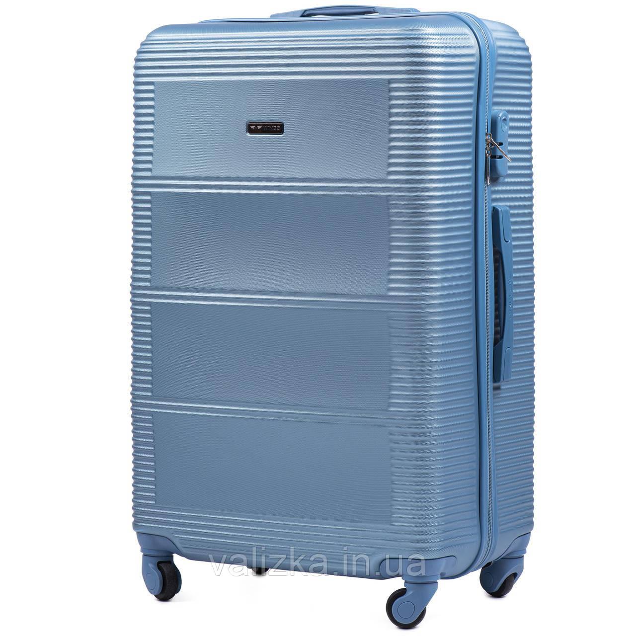 Средний чемодан из поликарбоната Wings 203 на 4-х колесах голубой