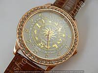 Часы Mundell Знаки зодиака 013337 женские золотистые с коричневым