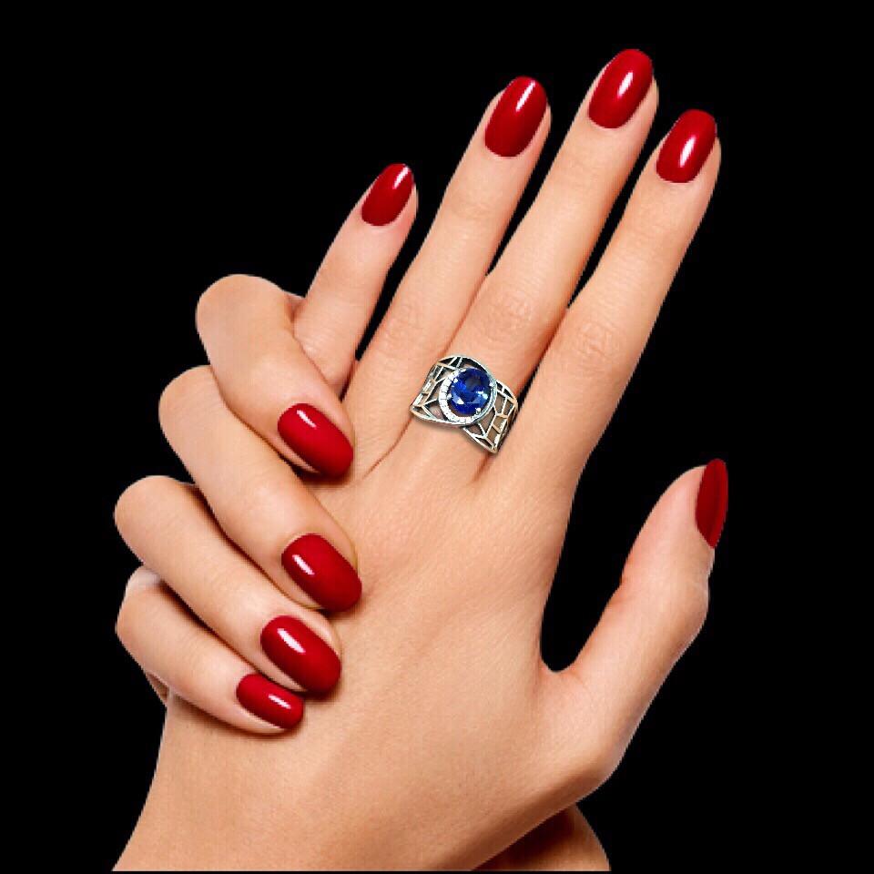 Широкое серебряное кольцо с цветным камнем