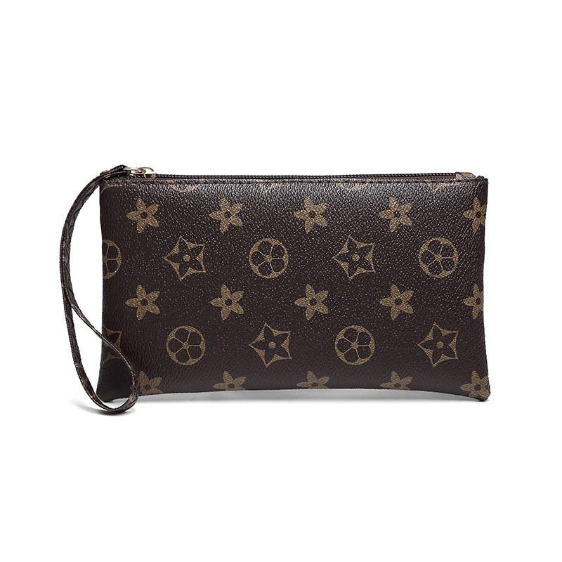 Жіночий гаманець у квіточках 11.5х20х2 см