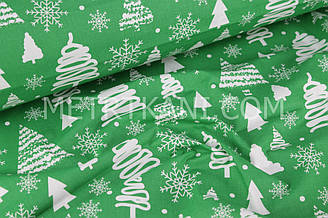 "Новогодняя ткань  ""Елочки и снежинки  "" на зеленом фоне № 502"