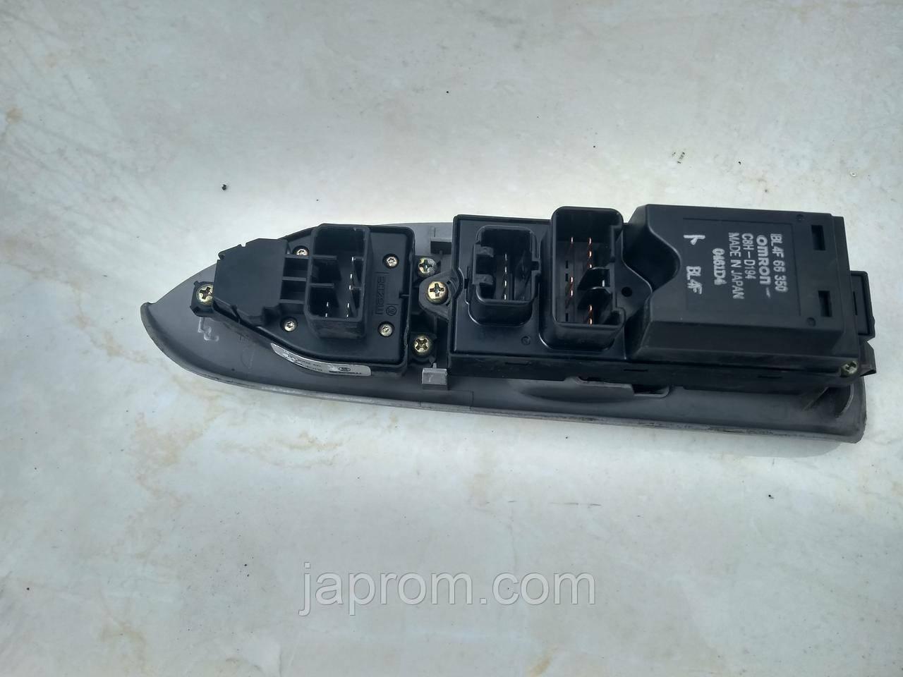 Блок кнопок стеклоподъемников и регулировки зеркал(на 4дв) Mazda 323 BJ Рестайл