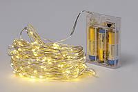 Гирлянда 100 мини-LED: 1 линия 10 метров, 100 диодов/ нить, цвет - тёплый белый, постоянное свечение, адаптер на 3AA батарейки