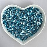 Пайетки 2 мм (Индия). Круглая плоская. Цвет: Голубой (металлик). Упаковка 5 гр., фото 2