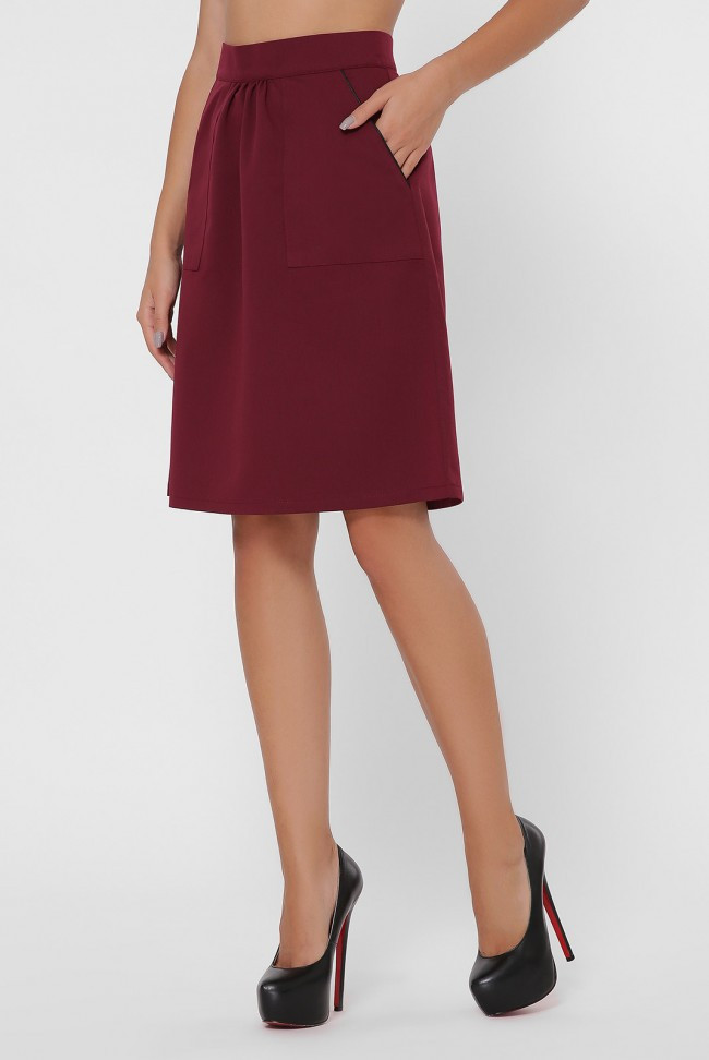 Женсккая юбка А-силуэта до колен с накладными карманами