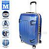 Стильный пластиковый чемодан на колесах, синий