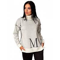 Оригінальний жіночий светр під горло