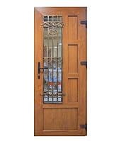Двери входные металлопластиковые с окном и ковкой