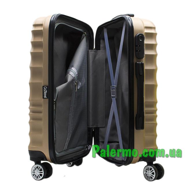 пластиковый дорожный чемодан коричневый