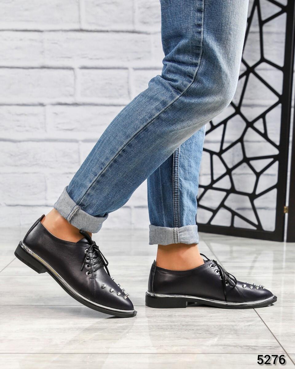 Стильные туфли с шипами