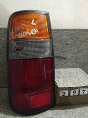 №297 Б/у фонарь задний лівий для Toyota Land Cruiser 80 1990-1998 дифект