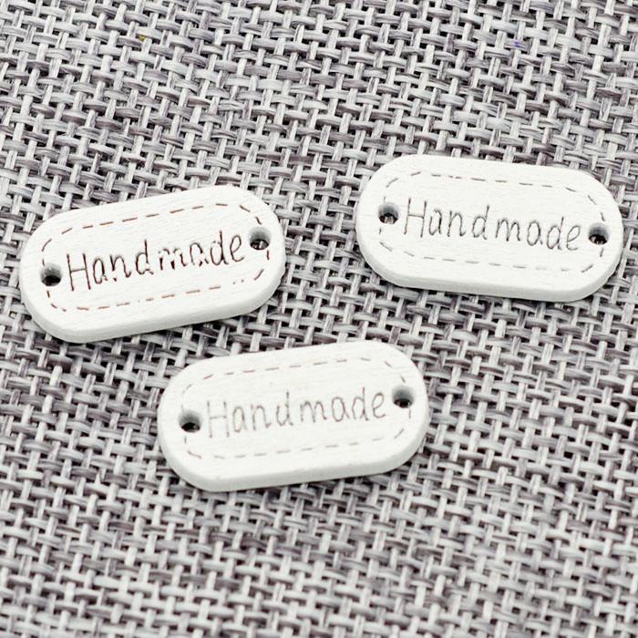 "Проставка, бирка пришивная ""hand made"" Размеры: 22x11х5 мм. 50 штук"