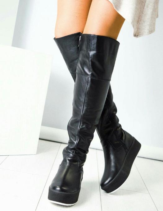 Как выгодно купить женские зимние ботфорты и создать неповторимый образ?