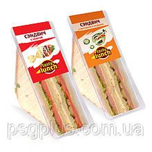 Упаковка сендвічів в трикутні лотки