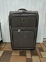 Дорожня валіза на колесах коричнева