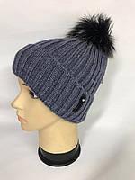 Тепла шапка з помпоном