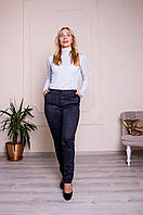 Женские брюки в клетку с манжетами
