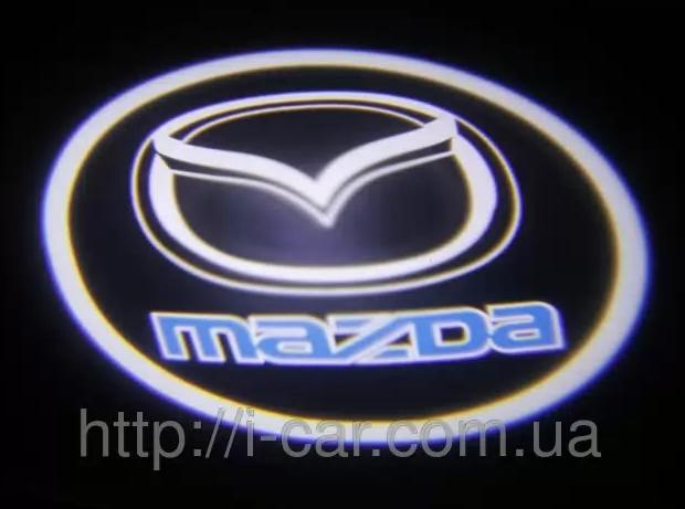 Проекция логотипа автомобиля MAZDA