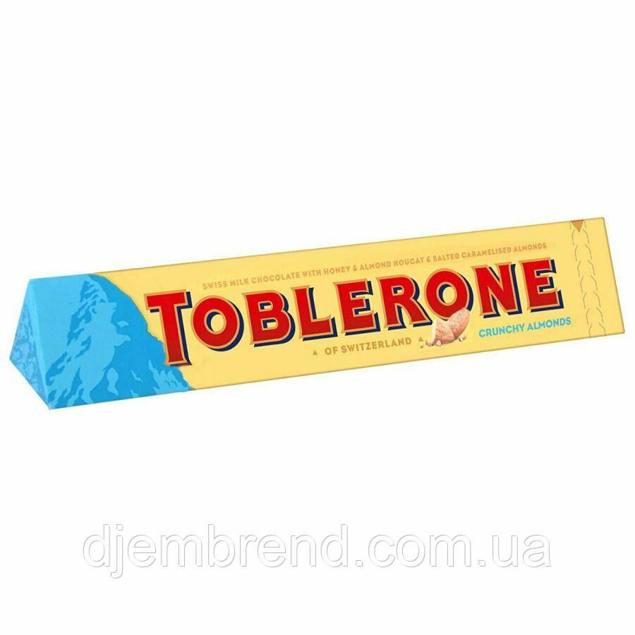 Toblerone Швейцарский молочный шоколад с медом, миндальной нугой и соленым карамелизированым миндалем, 100г