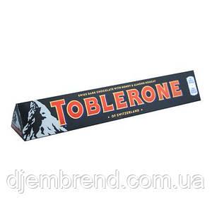 Toblerone Швейцарский черный шоколад с медом и миндальной нугой, 100г