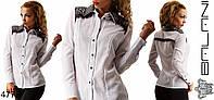 Женская блуза с перфорированными плечами